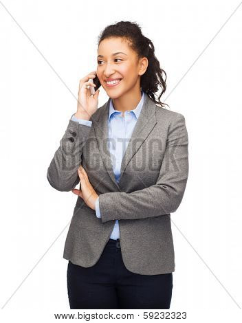 business, internet and technology concept - smiling african-american woman looking at smartphone