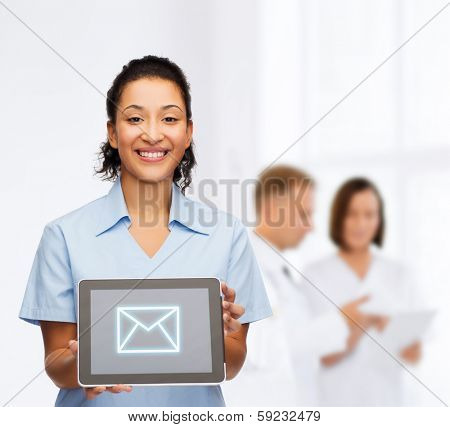 healthcare, connection, medicine and technology concept - smiling african american female doctor or nurse with tablet pc computer