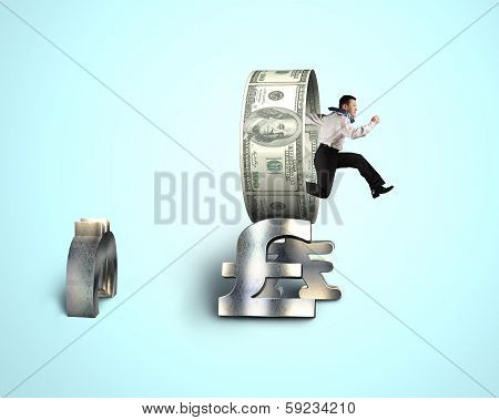 Businessman Jumping Through Currency Circle On Stack Money Symbols