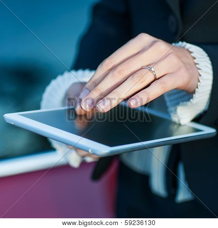 Young Woman Uses Tablet