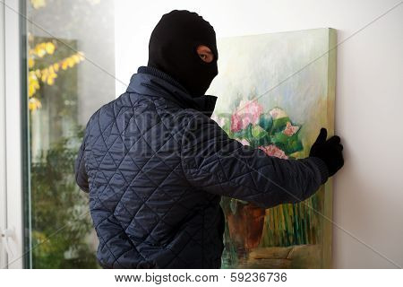 Man Taking Off Painting