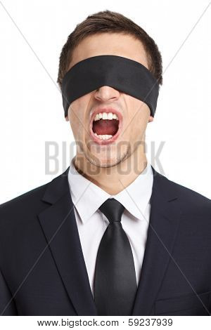 Portrait of blind-folded businessman who screams, isolated on white. Concept of slavery and violence