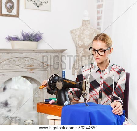Tailor Working In The Fashion Atelier