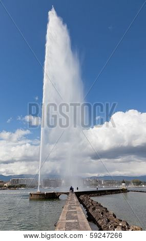 A fountain Jet d Eau rises over the waterfront of Lake Geneva