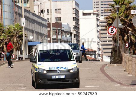 Police Vehicle Patrolling Street In Durban South Africa