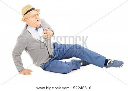 Middle aged gentleman laying on the ground having a heart attack isolated on white background