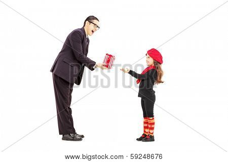 Full length portrait of a man giving present to a little girl isolated on white background