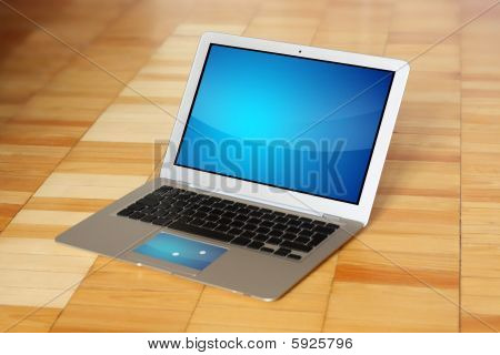 Modern Conceptual Laptop On Wooden Floor
