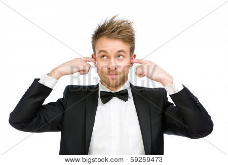 Half-length portrait of executive closes his ears, isolated on white. Concept of noise and stress