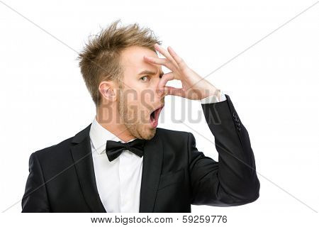 Portrait of businessman covering his nose, isolated on white. Concept of stink and disgust