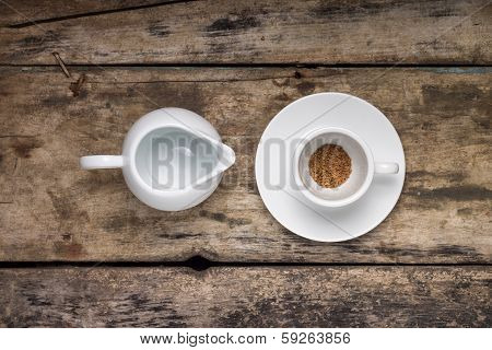 Instant Coffee In Empty Cup With Empty Milk Jag