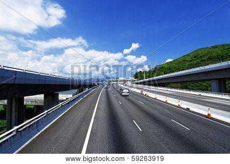 asphalt road in Hongkong, blue sky