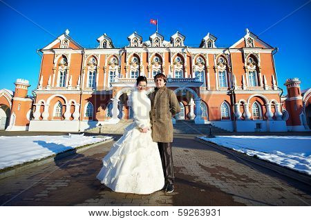 poster of Couple Near Petrovsky Putevoy Palace In Moscow