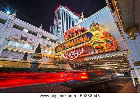 ATLANTIC CITY, NJ - SEPTEMBER 8, 2012: Taj Mahal Casino at night. The casino is owned by Trump Entertainment Resorts and modeled after the Taj Mahal in India.