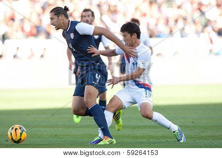 CARSON, CA. - FEB 01: USA D Omar Gonzalez #4 & Korea M Min-Woo Kim #15 during the U.S. mens national team soccer friendly against Korea Republic on Feb 1st 2014 at the StubHub Center in Carson, Ca.