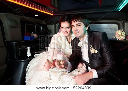 Bride And Groom With Champagne