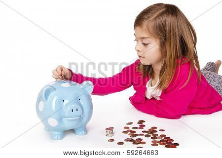 Child Saving money in a piggy bank