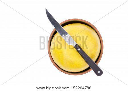 Kitchen Knife On A Ripe Yellow Grapefruit