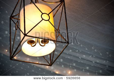Hanging Lamp Glowing With Tooling  And Mini Lights Behind