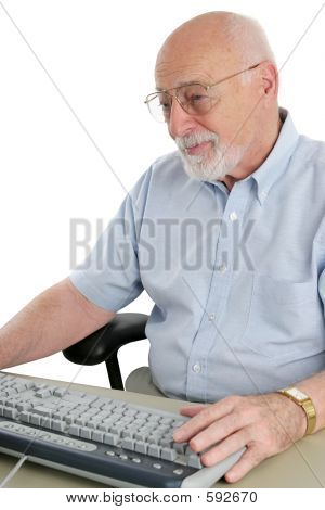Senior Man Enjoys Computer