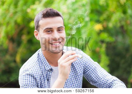 Man smoking an electronic cigarette outdoors