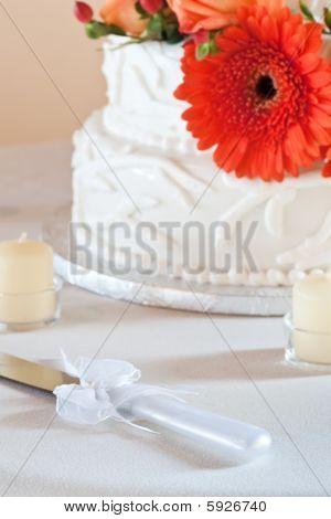 Wedding Cake Closeup With Orange Daisy