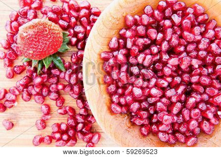Pomegranate Seeds With A Strawberry