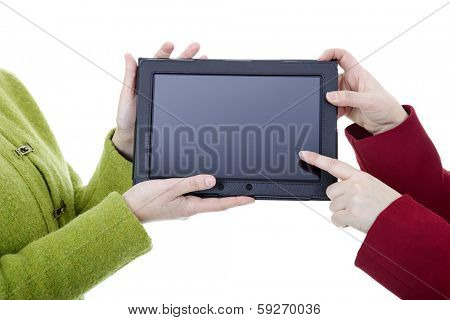 Two women with a digital tablet, isoated, detail