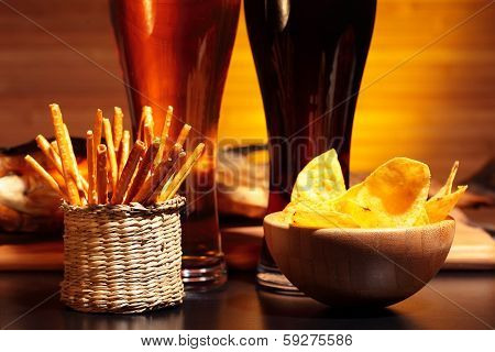 Glasses of  beer with chips and snacks