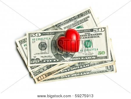 top view of red heart of stone on american dollars on white background