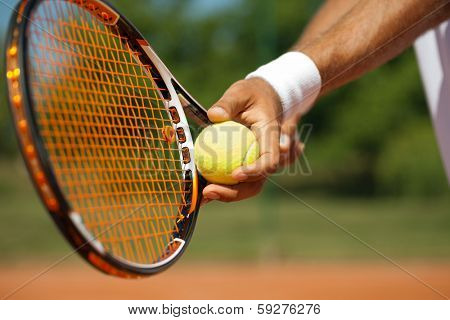 Close up of a tennis player standing ready for a serve