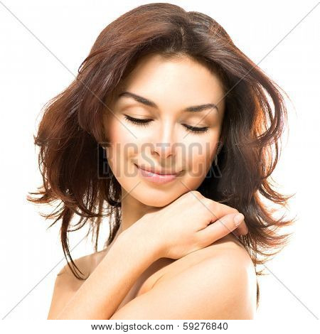 Beauty Woman. Beautiful Young Female touching Her Skin. Portrait isolated on White Background. Skincare concept. Healthcare. Perfect Skin. Beauty Face.