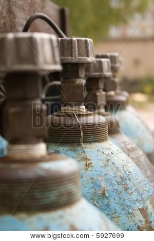Close-up Of Blue Gas Cylinders