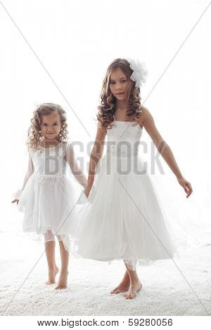 Beautiful little children wearing flower girl dresses