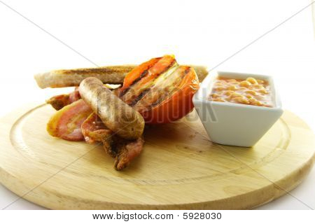 Cooked Breakfast Items On A Wooden Plate