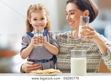 girl drinking milk at the kitchen