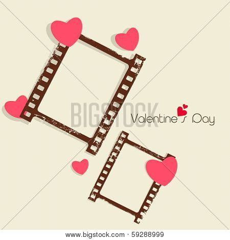 Happy Valentines Day celebration concept with blank photo frame set on brown background, love concept.