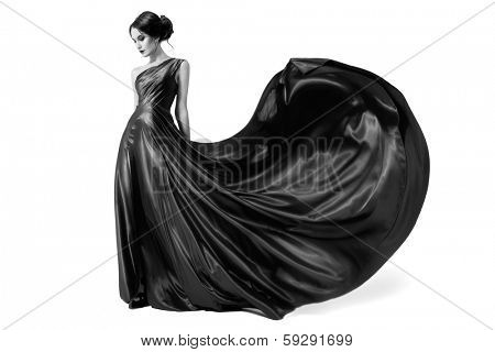 Fashion woman in fluttering dress. Black and white image. Isolated on white background.