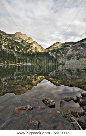 Alpine Mountain Lake And Reflection