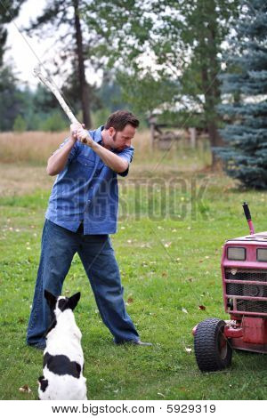 Man Beating Lawn Mower