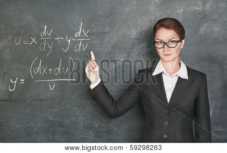 Woman Teacher Teaching Maths