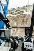 picture of heavy equipment operator  - View inside cabin of modern crane operator - JPG
