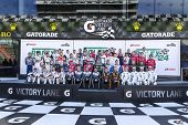 Daytona Beach, FL - Jan 24, 2014:  The field of champions pose for their group photo before the Role