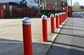 stock photo of raid  - Steel security bollards outside a building to protect from the threat of crime and terrorism - JPG
