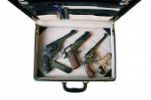A genuine briefcase filled with Guns. Could be a Hit Man's Arsenal, or a FBI Sting or CIA Mole or a