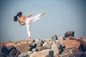 foto of karate-do  - Young girl training karate - JPG