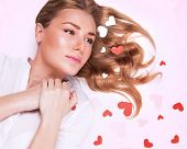 Young lady in love, closeup fashionable portrait, lying down, beautiful glossy hair, many little hea