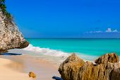 stock photo of caribbean  - Tulum beach near Cancun turquoise Caribbean water and blue Sky - JPG