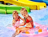 pic of inflatable slide  - Child on water slide at aquapark - JPG