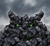 pic of landfills  - Garbage monster at a dump as mountains of black trash bags with an unpleasant smell shaped as an evil character with glowing green eyes and bad breath in an infinite landfill heap landscape as a background of environmental damage - JPG